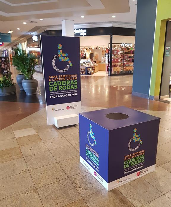 São Gonçalo Shopping - Campanha doação de tampinhas e lacres